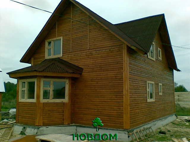 Дом из бруса в полтора этажа с эркером